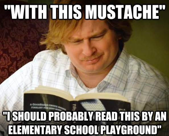 Curious Male Reads Fifty Shades With A Mustache