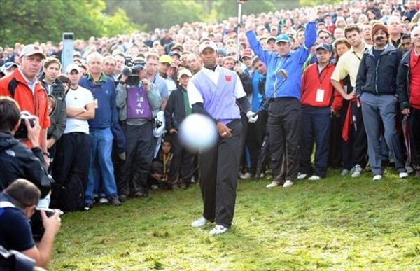 Tiger Woods Hits A Golf Ball Into The Camera