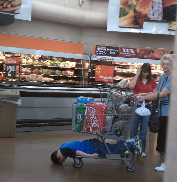 Kid In Grocery Cart At Walmart