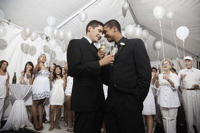 Two bros getting married in front of their friends and family.
