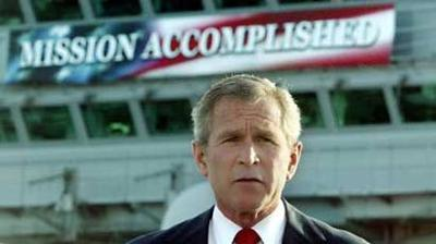 George Bush in front of the mission accomplished banner