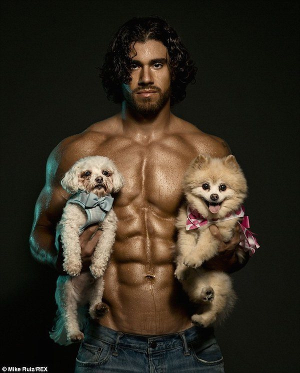 Man With Great Abs And Two Puppies