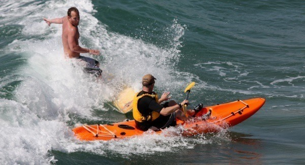 Surfer And Kayaker