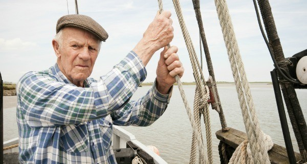 Old Man On Boat