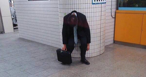 Man Asleep On Tokyo Subway