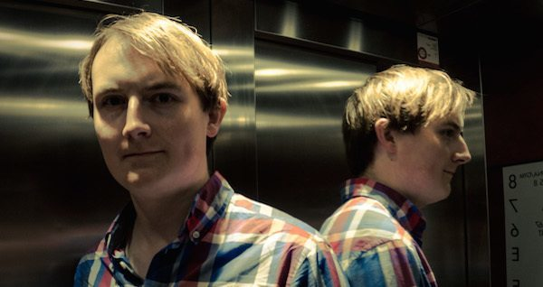 Man Reflected In Elevator