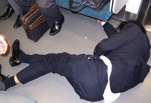 Sleeping On Floor Of Subway