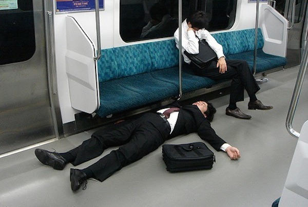 Two Men Sleeping On Tokyo Subway