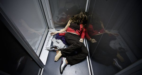 Women Laying In Elevator