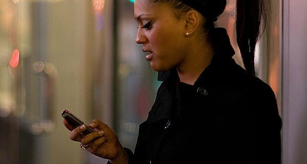 Woman Checking Phone Notes