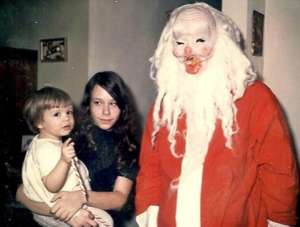 Creepy Santa Clause In A Family Picture