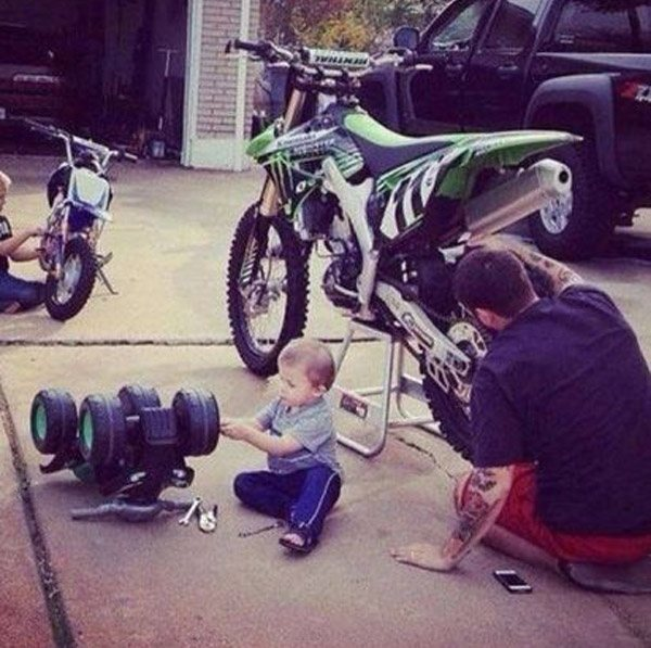 Dad Son Working On Bike