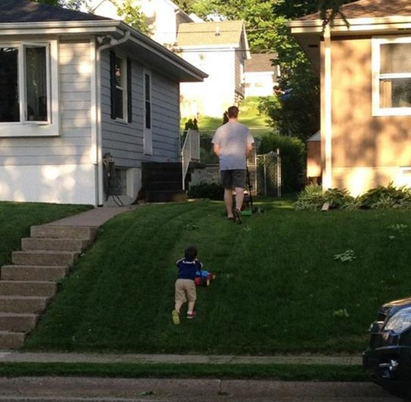 Father Son Mowing Yard